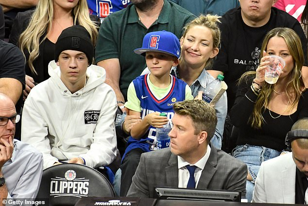 Upbeat: Kate Hudson had good reason to smile on Tuesday evening as her beloved Los Angeles Clippers triumphed against local rivals the Lakers
