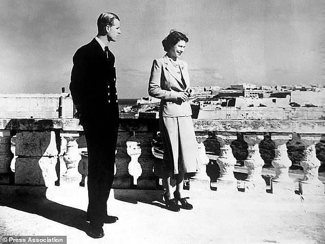 The couple view Valetta from the roof of Villa Guardamangia in November 1949