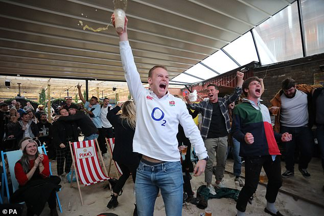 England fans (pictured in London) went wild as the country made it to the Rugby World Cup final after beating the reigning champions New Zealand in a thrilling 19-7 match