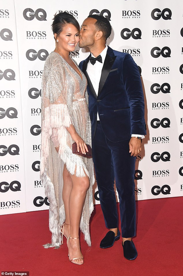 Going strong: Chrissy and John celebrated their five year anniversary earlier in the year (pictured 2018)