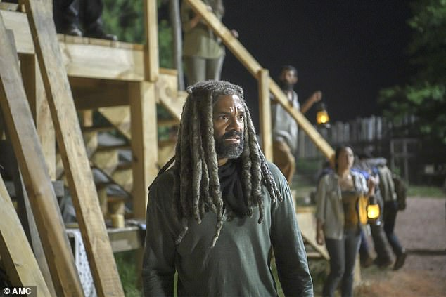 Natural disaster: Ezekial [Khary Payton] was overwhelmed as a giant tree fell on a building at Hilltop, trapping people inside
