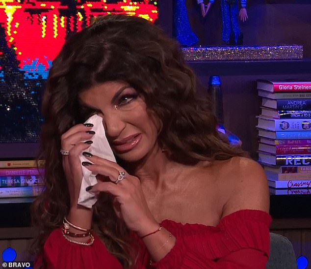 Tears flowing: Teresa Giudice wiped away tears while watching clips of her daughters struggle with her husband Joe's imprisonment during a special episode Sunday on Bravo