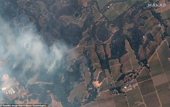 The low humidity and wind in the area has contributed to the fast movement of the fire, as it burned through some 10,000 acers in just a few hours - Some gusts have been reported at up to 70 mph. Pictured is an image captured by the WorldView-3 satellite