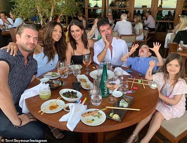 Pals: Simon celebrated his 60th with a small dinner with partner Lauren, son Eric, five, and ex and close friend Terri Seymour at Nobu in Malibu on his official birthday on Monday 7 October (Simon pictured with Lauren, centre, Terri, left, and son Eric, right, in August)