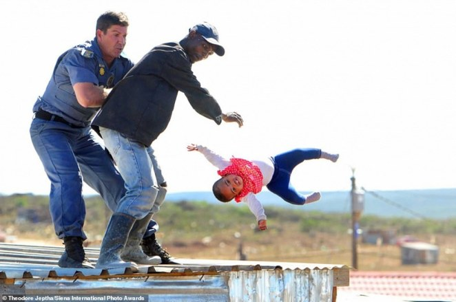 This shocking image has been shortlisted in the Documentary & Photojournalism category. It was taken byTheodore Jeptha in an illegal township in Port Elizabeth and caught the harrowing moment in 2018 that a father threw his baby daughter off the roof of a shack. Fortunately, she was caught by a policeman and did not suffer any injuries. The father, who was charged with attempted murder, claimed his actions were in protest at his home being demolished