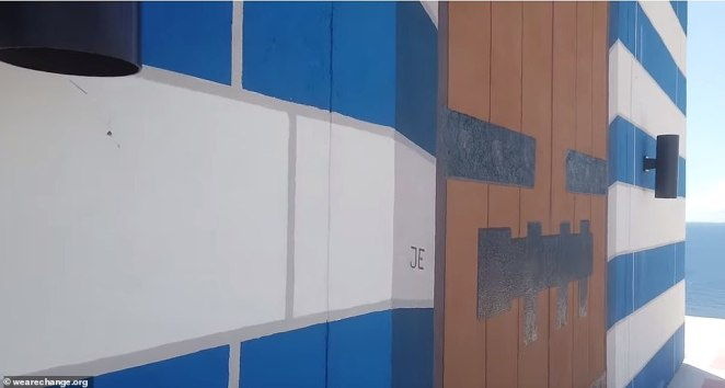 FAKE:The video revealed that the wooden doors on the island's infamous temple are painted on and not real