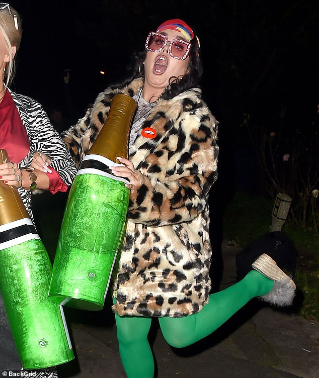 Fun:The former Gogglebox star, 29, went all out for her look in an oversized faux fur leopard print coat with green tights and a snakeskin patterned skirt