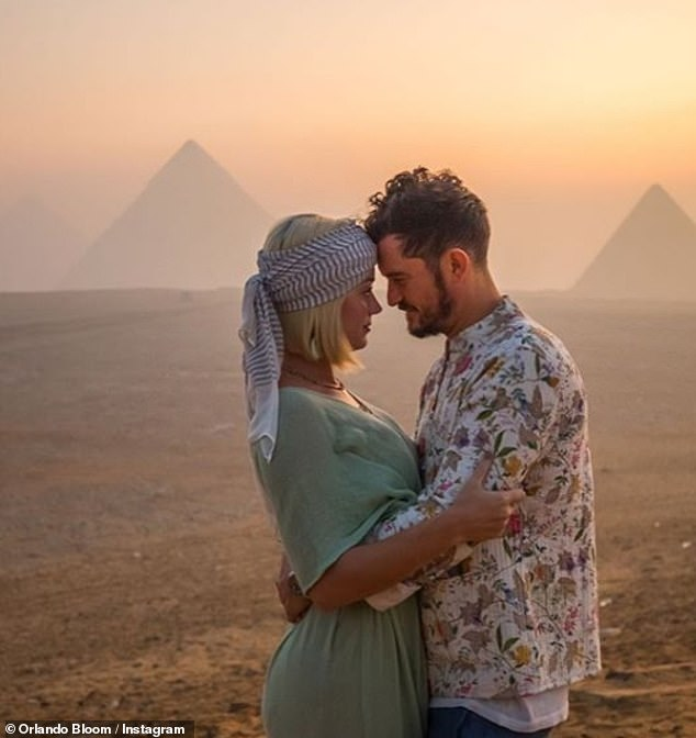 Romantic: Katy Perry celebrated her 35th birthday in spectacular fashion as she flew to Egypt for an idyllic desert break with fiancé Orlando Bloom (pictured) and 64 friends