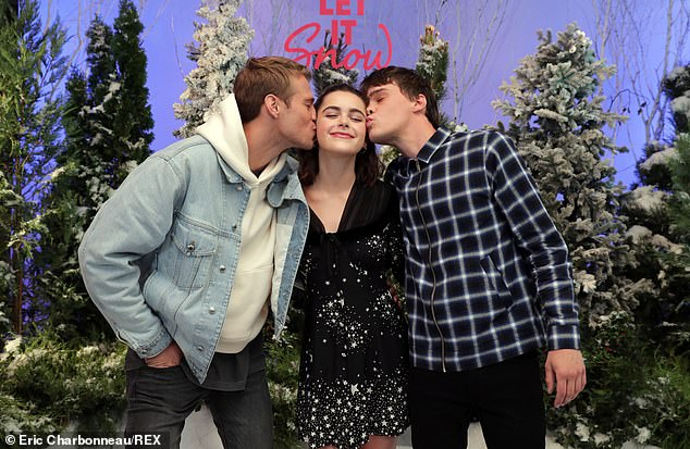 Between: Shipka's character is based on the book's the Duke, a tomboy whose real name is Angie, and her friendship with a boy named Tobin, played by Mitchell Hope. Hope and Moore were at the photo call. Hope posed with Matthew Noszka to plant kisses on both sides of Shipka's face