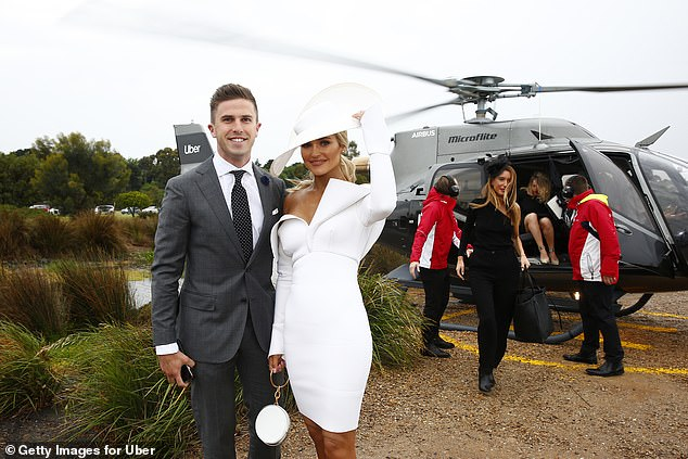 Showing up in style!AFL WAG Jessie Habermann and her husband Marc Murphy looked very loved-up as they arrived at the annual racing event on Saturday