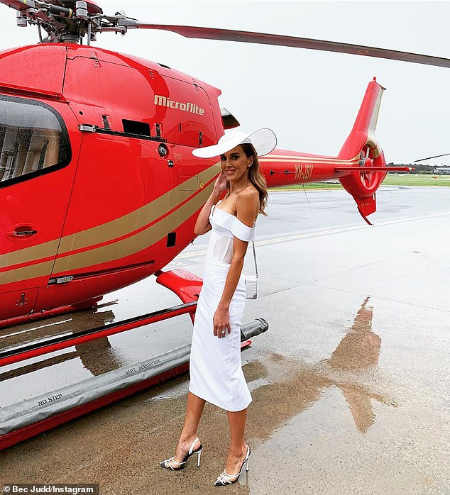 She's got style!Bec Judd showed off her svelte figure in a tight white dress with mesh detailing around the waist