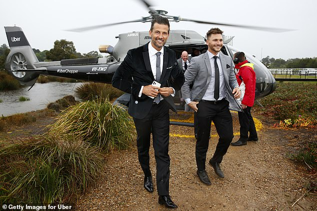 All smiles!The hunky Bachelor star beamed as he stepped out of the helicopter with Michael, who donned a smart grey suit for the occasion