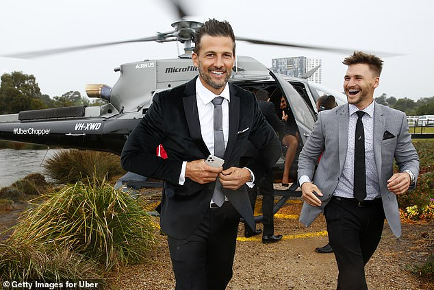 Super suave!Tim Robards looked dapper as ever as he arrived via chopper on Saturday morning, alongside pal Michael Ramsey