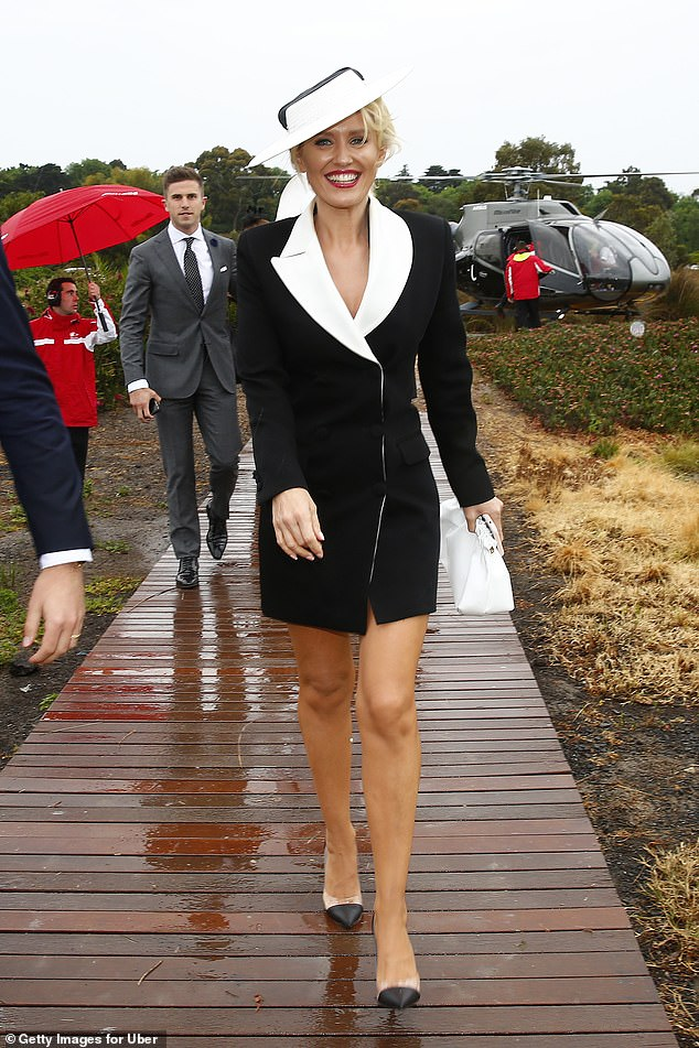 Arriving in style! Actress Nicky Whelan braved the drizzly weather in a pin-flashing suave ensemble