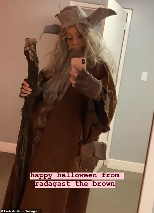 Cross-dressing: Paris showed off her Lord Of The Rings costume from last week on Instagram Thursday and referred to herself and her boyfriend Gabriel Glenn as 'gay wizards'