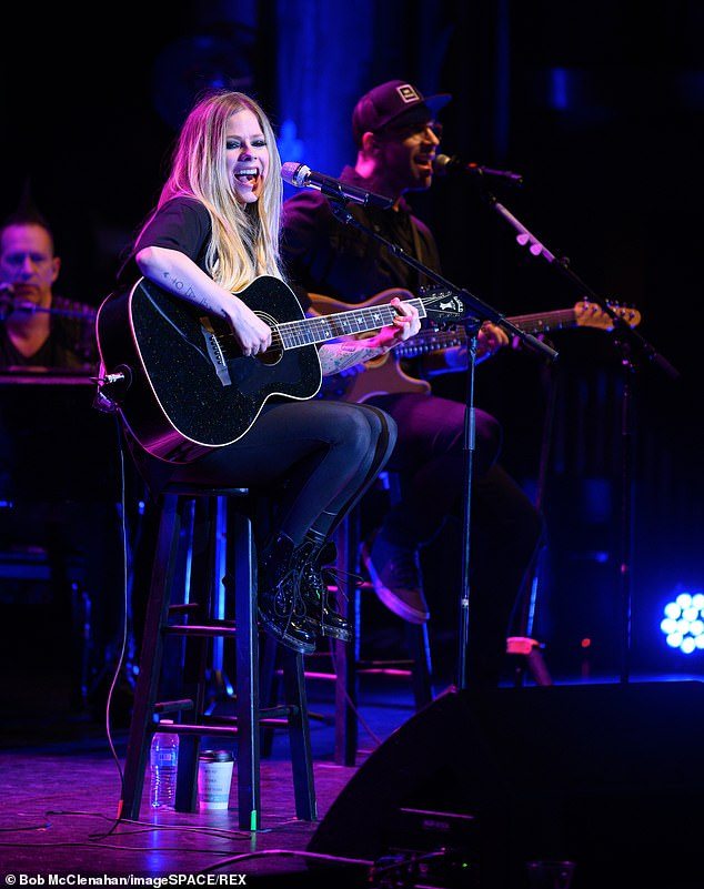 Avril kept things cool in casual as she donned a baggy black top and a skinny black jeans and her standard grunge boots