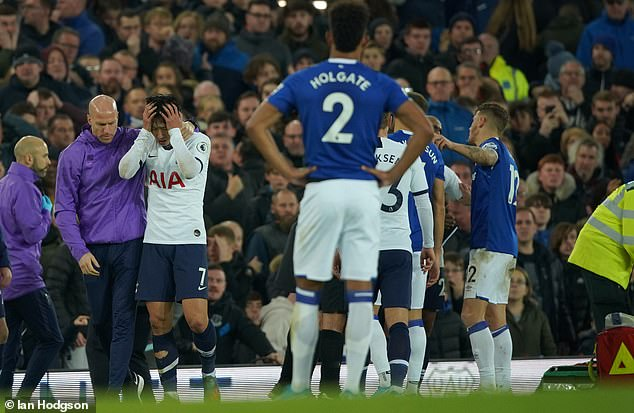 A distressed Son (No 7, left) has his head in his hands after seeing Gomes' horrific injury