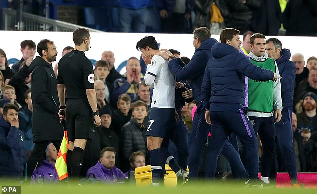 An upset Son leaves the pitch after being shown a straight red card for his tackle on Gomes