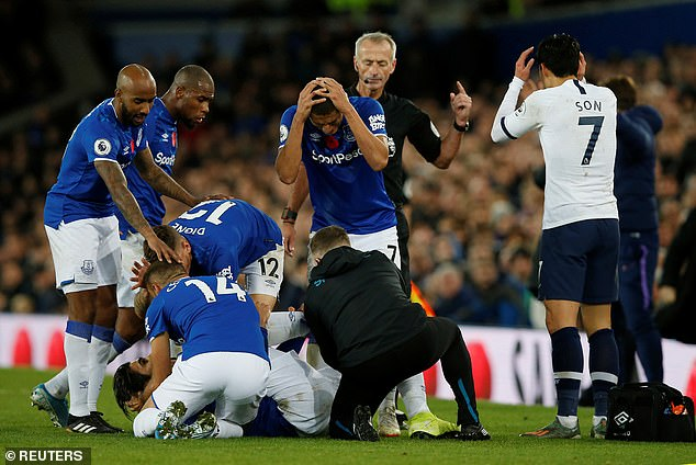 Everton's players immediately crowded around Gomes and looked distraught as they saw the extent of his injuries