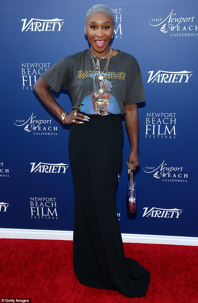 Punk princess: Cynthia Erivo added a fun twist to her red carpet look, sporting a distressed grey Iron Maiden t-shirt, tucked into a floor-lenght black skirt