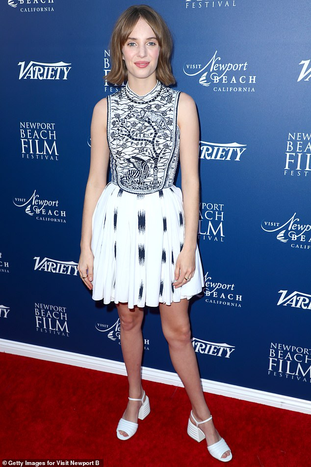 The blues: Maya Hawke donned a white dress, featuring an intricate blue tree embroidery on a bib with splashes of blue on the skirt
