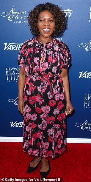Pink floral: Alfre Woodard was also in attendance, sporting a black flowy dress with a pink floral print