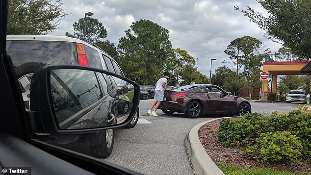 Wild photos and videos from a Popeyes at Union Park, Florida, show desperate customers pushing their car through the drive-thru in a bid to get their hands on the viral sandwich