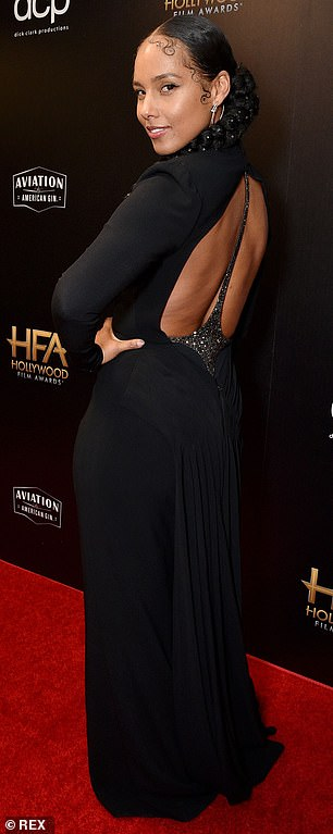 Backless in black: She did a turn to reveal a backless cutout, featuring a sparkling black strap running up the middle