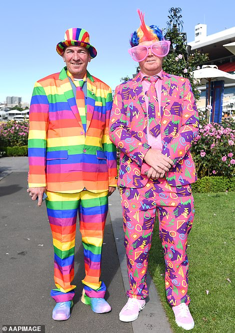 Two racegoers opted for very colourful outfits