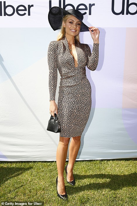Va va voom! Elyse Knowles turned heads in a plunging leopard-print frock as she led the celebrity arrivals at The Melbourne Cup 2019