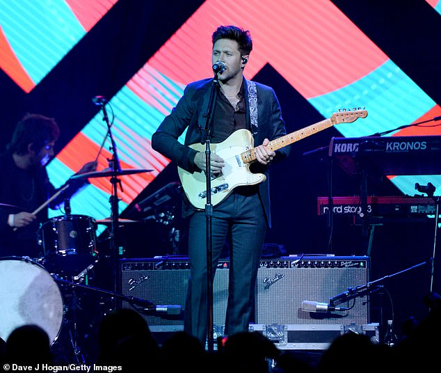 Performance: Niall played a cream-coloured electric guitar with a funky strap at the awards