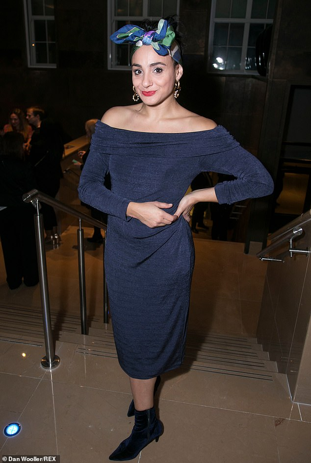 Stylish: Actress Victoria Hamilton-Barritt looked radiant in a navy off the shoulder dress and black ankle boots