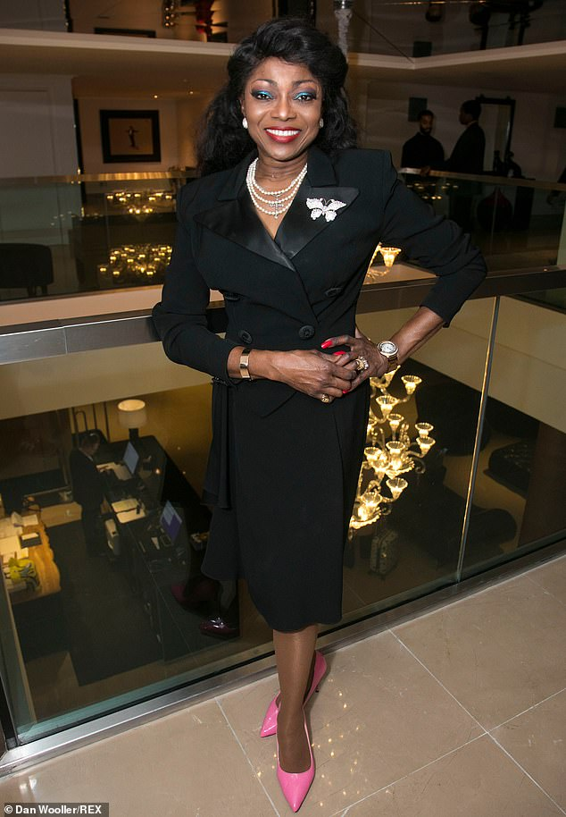 Outfit: Patti Boulaye cut a stylish figure in a black coat with bright pink heels