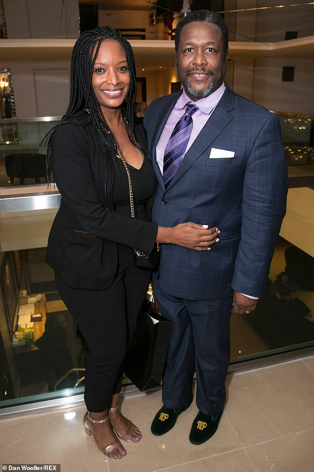 Stars: Many of the show's cast attended the bash including lead actor Wendell Pierce who made his West End debut as Willy Loman (pictured with Erika Woods)