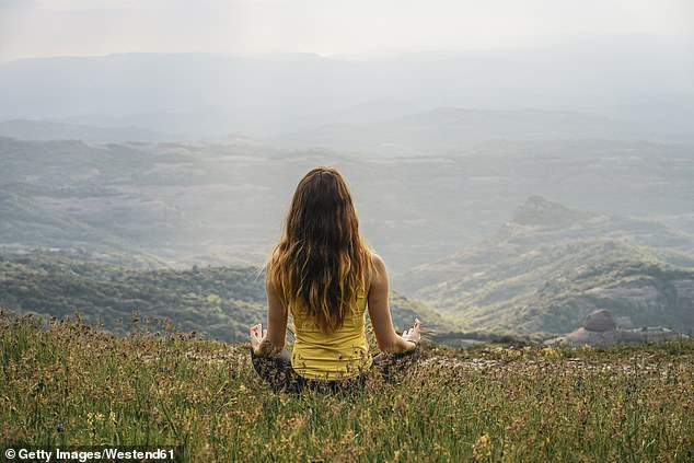 Moon breathing can help fight insomnia by calming the nervous system. Another technique called 'alternative breathing' can help cope with anxiety attacks. Woman meditating, stock image