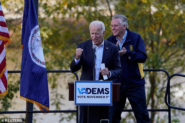 In Virginia, former Vice President Joe Biden (left)  - running for the 2020 Democratic nomination - stands alongside former Virginia Gov. Terry McAuliffe at a 'Get out the Vote' rally in Sterling, Virginia Sunday