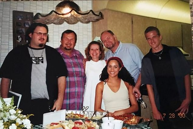 Meghan is estranged from the majority of her father Thomas's side of the family, including her dad (in blue) her other uncle Fred (checkered shirt) and her half-siblings