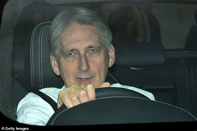 Philip Hammond on Tuesday announced he will not be contesting the general election on December 12 (he is pictured leaving the Houses of Parliament last month)