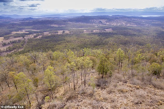 The 260-acre property 100km north-west of Brisbane commands views over the nearby Lake Wivenhoe (pictured in background) but its summit can only be accessed by four-wheeled drive
