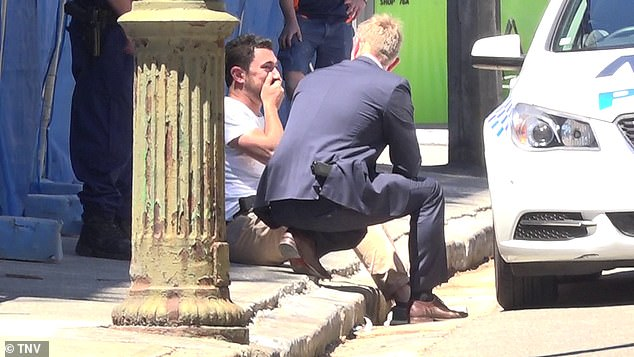 Shocked workers spoke to investigators at the scene of the stabbing in Sydney's inner-west