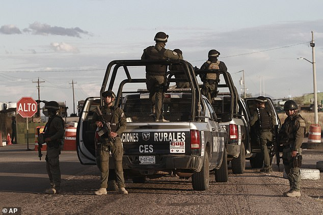 Chihuahua state police officers man a checkpoint in Janos following the grisly attack