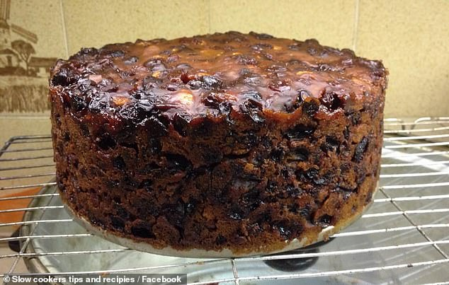 This lavish Christmas cake (pictured) was cooked using just four ingredients and 'baked' for eight hours in a slow cooker