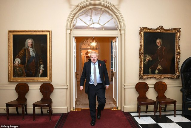 Mr Johnson (pictured in the entrance hall at 10 Downing Street today) told staff the 'bugle is sounding' and he is 'heading for the front'