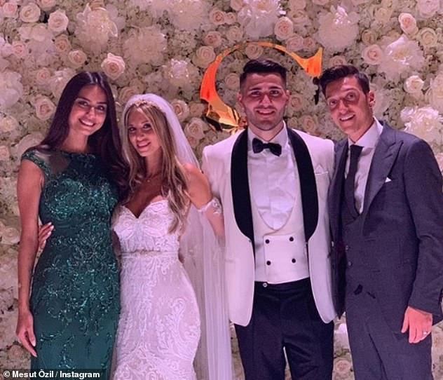 Mesut Ozil (far right), his wife Amine Gulse (far left) with Sead Kolasinac and his brideBella Kolasinac on their wedding day in June in Baden, Germany