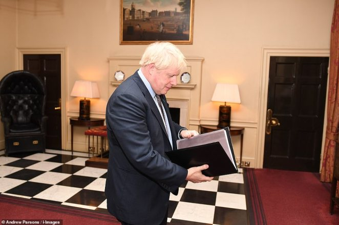 Mr Johnson had a last look at his notes before emerging through the door of No10 to deliver his election rallying cry