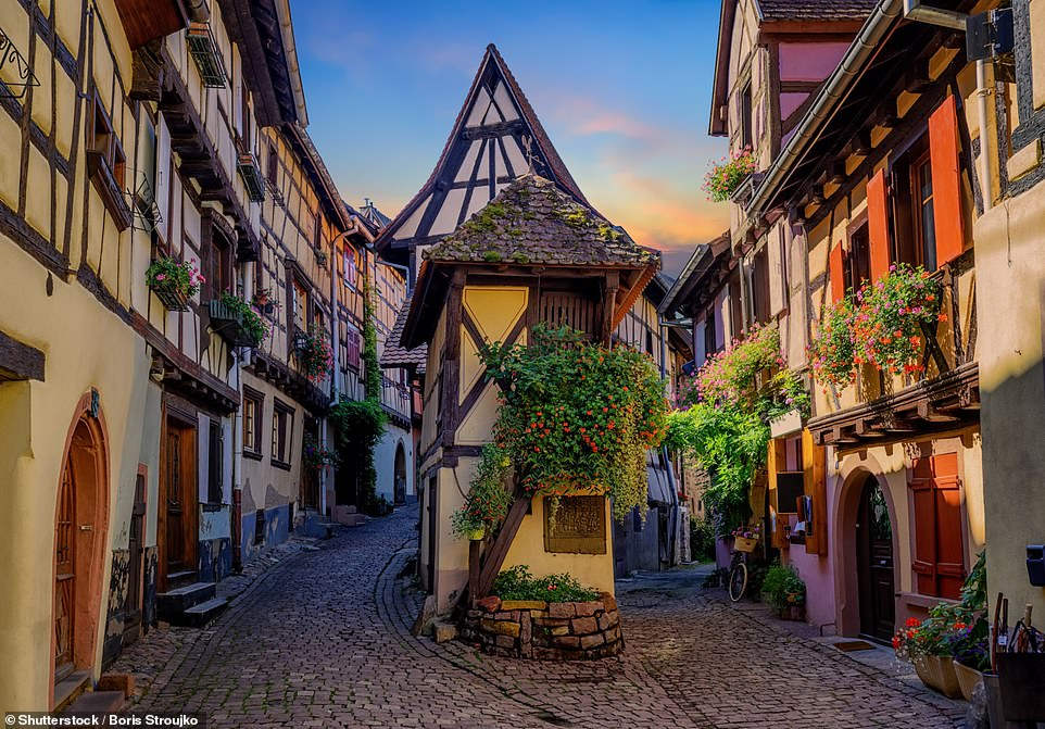 No, you're not looking at a set for a fantasy film - this is the village of Eguisheim, known for its chocolate-box houses and for being the birthplace of wine-growing in the Alsace, according to the tome