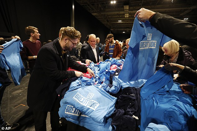 T-shirts emblazoned with Mr Johnson's policy priorities were handed out to Tory activists ahead of this evening's event in Birmingham. One reads 'Get Brexit Done' while another reads '20,000 more police officers'