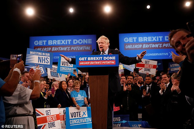 Boris Johnson, pictured in Birmingham this evening, said a 'tidal wave of investment' was ready to flood into the UK once Brexit is resolved