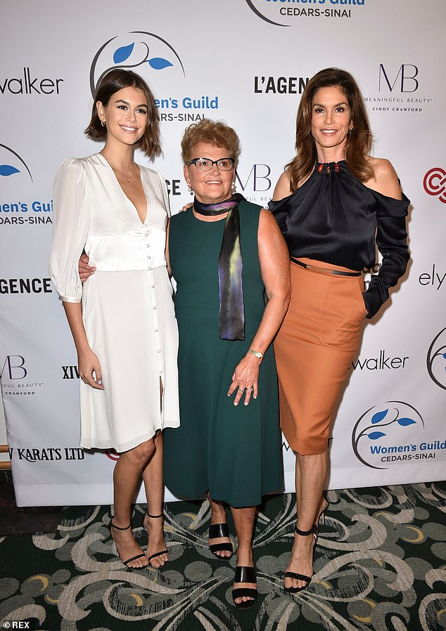 Ladies who lunch: The family matriarch wrapped her arm around her statuesque granddaughter, who practically towered over her grandmother