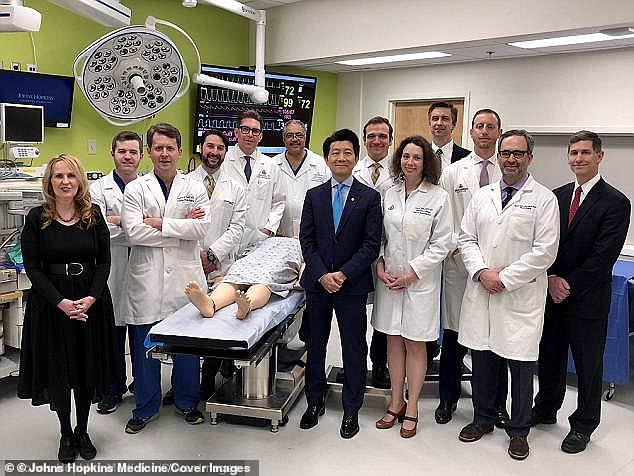 In 2018, medics performed the groundbreaking 14-hour surgical procedure performed at Johns Hopkins Medicine in Baltimore (part of the team pictured with a a surgical dummy 2018)
